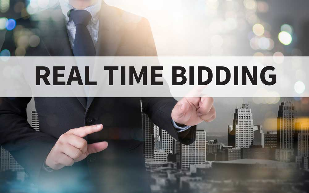 REAL TIME BIDDING and businessman working with modern technology [shutterstock: 444585412, one photo]