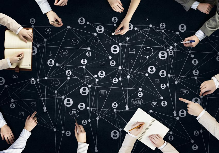 Information silos prevent company-wide cooperation. A network of projects can facilitate communication and increase flow. [shutterstock: 354362711, Sergey Nivens]
